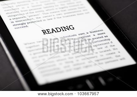 Reading On Tablet Touchpad, Ebook Concept