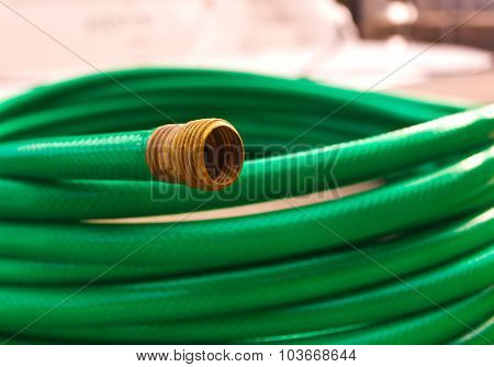 Green coiled rubber hose