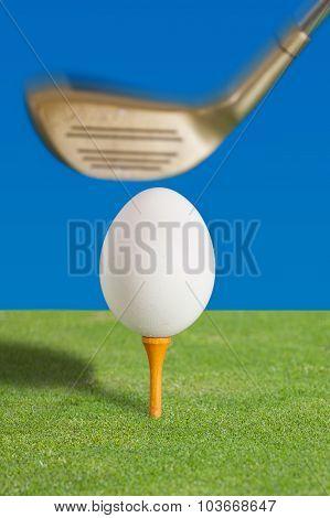 Egg on a golf tee