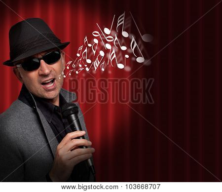Handsome man singing with musical notes coming out of his mouth