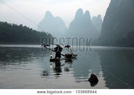 Yangshuo - June 19: Chinese Man Fishing With Cormorants Birds In Yangshuo, Guangxi Region, Tradition