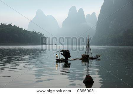 Yangshuo - June 18: Chinese Man Fishing With Cormorants Birds In