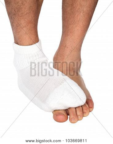 Man's foot with sock covers the other foot  Image ID: 74858212