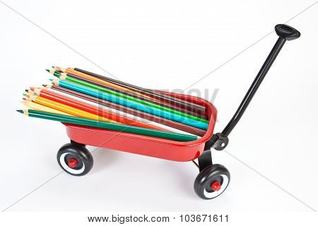 Red wagon with colorful pencils