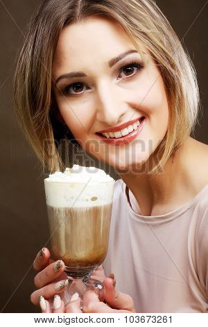young woman holding cafe latte cup