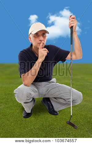 Handsome mature male golfer on the putting green