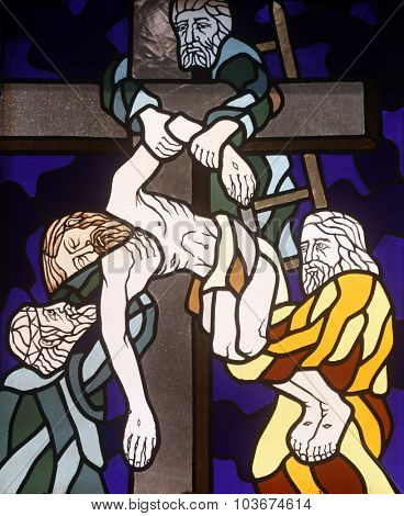 RIJEKA, CROATIA - JUNE 11: 13th Stations of the Cross, Jesus' body is removed from the cross, stained-glass window in the church of St. John the Baptist in Rijeka, Croatia, on June 11, 2011
