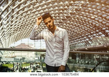 Handsome young man in train station or airport