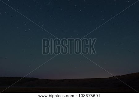 The night sky over the hill