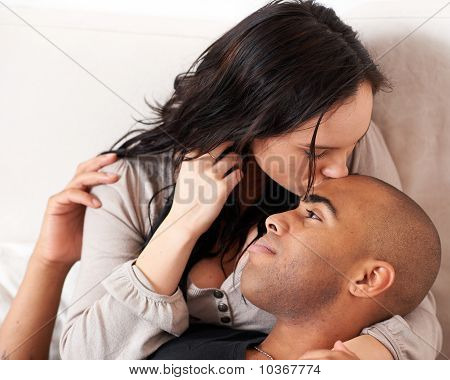 Attractive Smiling Couple Kissing