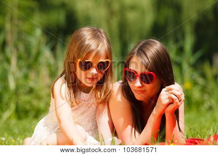 Mother And Daughter Having Picnic In Park