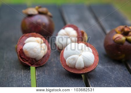 mangosteens on a wooden table