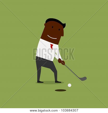 Businessman playing golf at green field