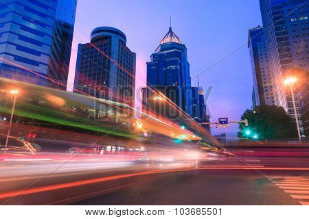 Light trails on a city street at dusk,China
