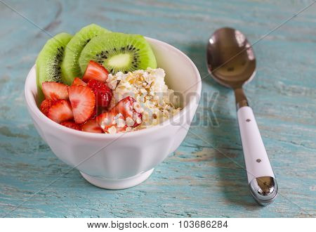 Cottage Cheese With Strawberries, Kiwi, Honey, Cereals And Seeds Of Flax - A Healthy Food, Tasty And