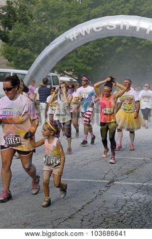Dye Splattered Color Run Crowd At The Finish