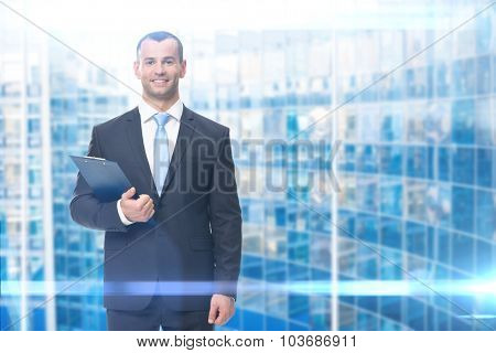 Portrait of businessman with folder, ion blue background
