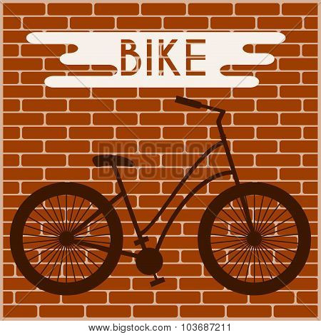 Bicycle Silhouette Against The Brick Wall
