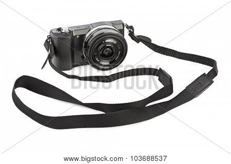 Mirrorless photo camera isolated on white background