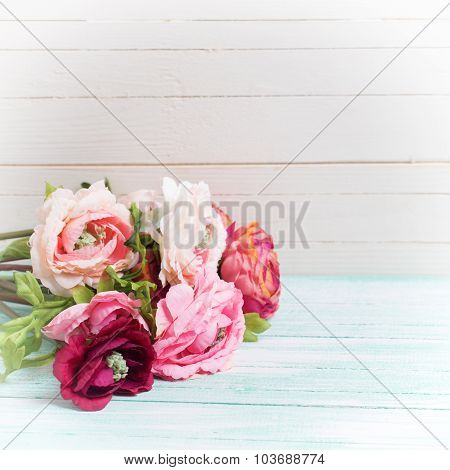 Flowers On Wooden Background