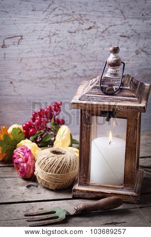 Autumn Still Life Photo With  Candle In Lantern  And Flowers