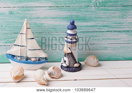 Decorative Lighthouse,  Sailing Boat And Marine Items On Wooden Background.