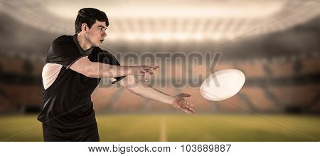 Rugby player doing a side pass against rugby arena