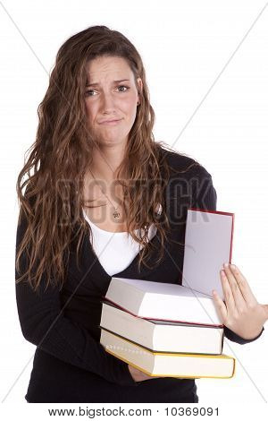 Holding Books Witn Frustrated Expression