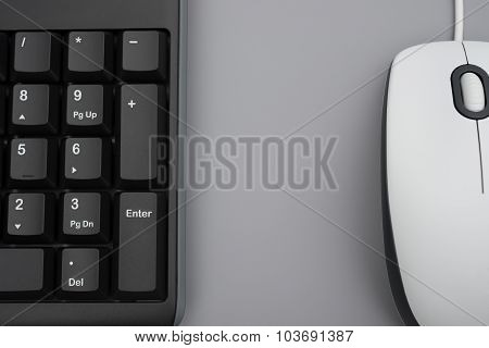 White Mouse And Black Keyboard On Grey