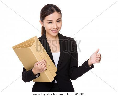 Young businesswoman hold with folder and thumb up