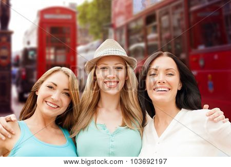 summer holidays, people, travel, tourism and vacation concept - group of smiling young women over london city street background