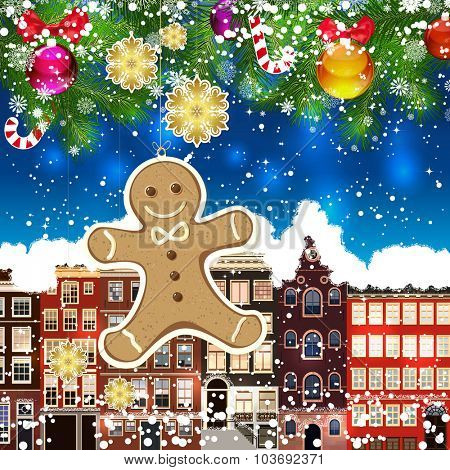 Christmas gingerbread man on the background of snow-covered streets. Green branches of Christmas trees decorated with Christmas balls and sweets. Christmas background.