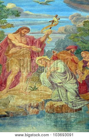 LJUBLJANA, SLOVENIA - JUNE 30: Baptism of the Lord, fresco on the facade of St Nicholas Cathedral in the capital city of Ljubljana, Slovenia on June 30, 2015