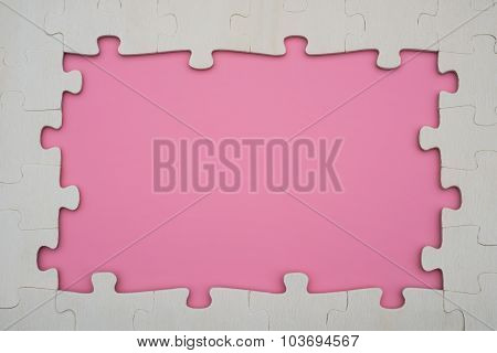 Jigsaw Puzzle Shaped Like A Framp On A Pink Background