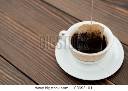 Cup Of Tea With Teabag On A Wooden Background
