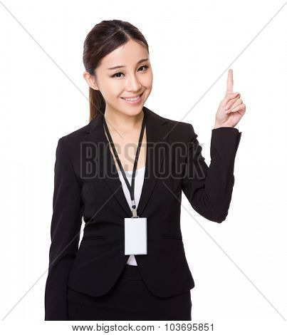 Asian young businesswoman hold wih name badge and finger point up