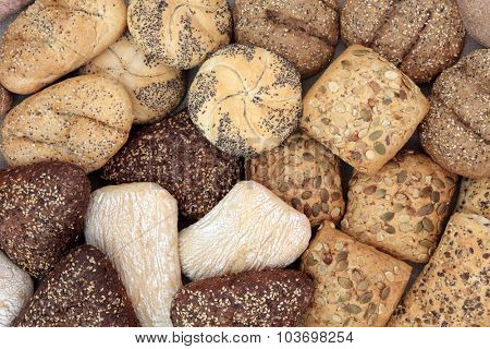 Fresh bread roll selection forming an abstract background.