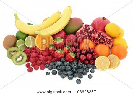 Large healthy fruit superfood selection over white background.