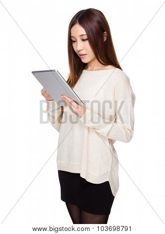 Asian woman read on the tablet pc
