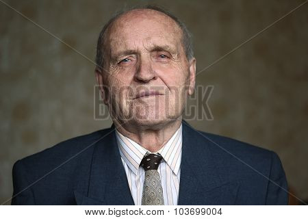 Grandfather in a good mood, thinking about the past