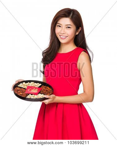 Chinese woman hold with snack tray