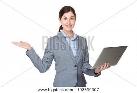 Caucasian businesswoman use of the laptop computer and open hand palm