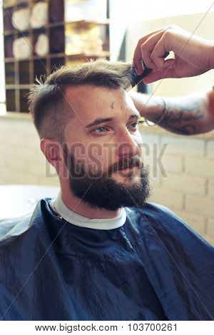 portrait of handsome man in barber shop