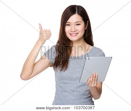 Asian woman use of the tablet pc and thumb up gesture