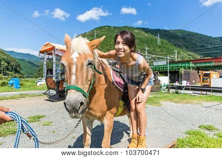Woman with horse in farm
