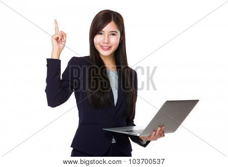Businesswoman use of the laptop computer and finger point up