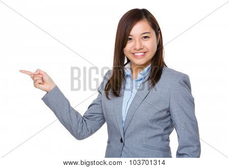 Asian Young businesswoman showing finger point aside