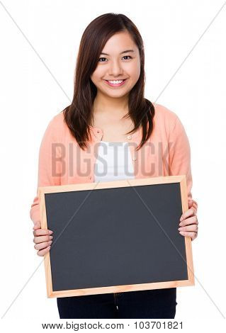 Woman show with the empty chalkboard