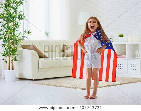 child holds a flag of America