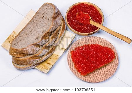 Sandwich With Red Caviar Bowl With Red Caviar And Bread